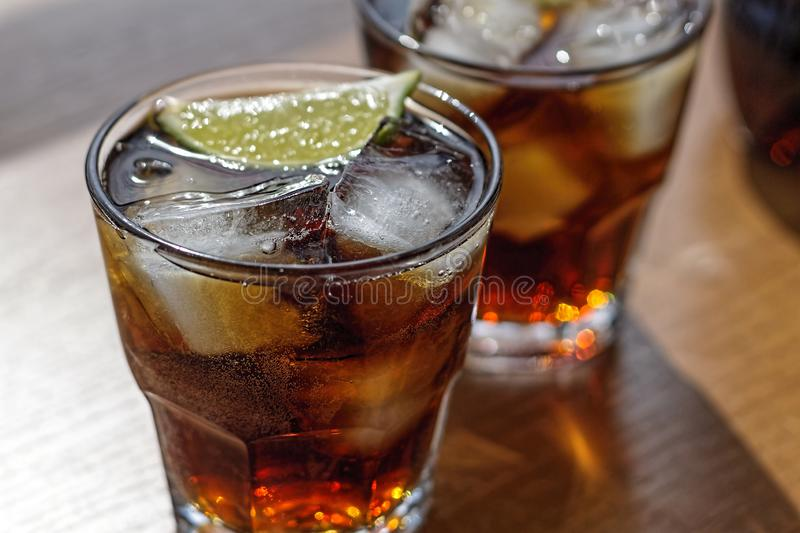 Rum, Cola, Cuba Libre, alcohol, ice, rum, glass, cocktail, refreshment, lime, cuba royalty free stock photos