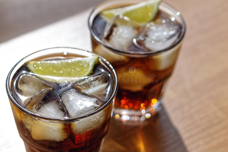 Rum, Cola, Cuba Libre, alcohol, Top view, ice, rum, glass, cocktail, refreshment, lime, cuba royalty free stock photo