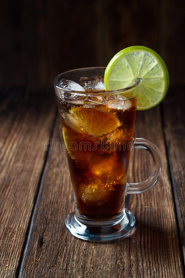Rum and cola Cuba Libre drink with brown rum, cola, ice and lime royalty free stock photos