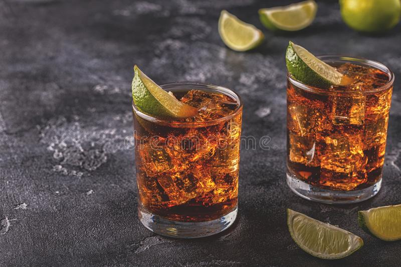 Rum and Cola Cuba Libre with Lime and Ice. Selective focus stock images