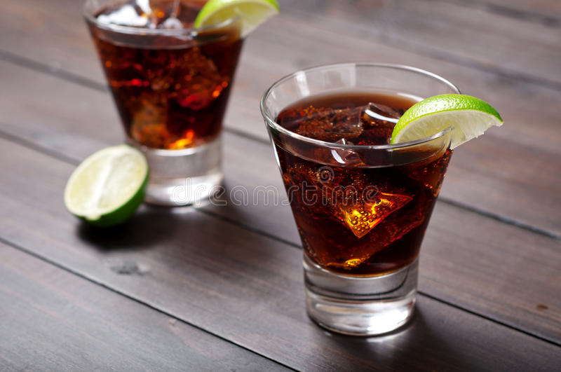 Rum and Cola Cuba Libre with Lime and Ice royalty free stock photography