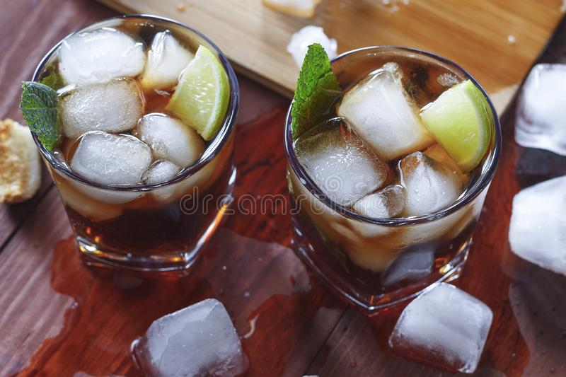 Rum, ice, party, lime, alcohol, drink, beverage, ice, rum, glass royalty free stock photos
