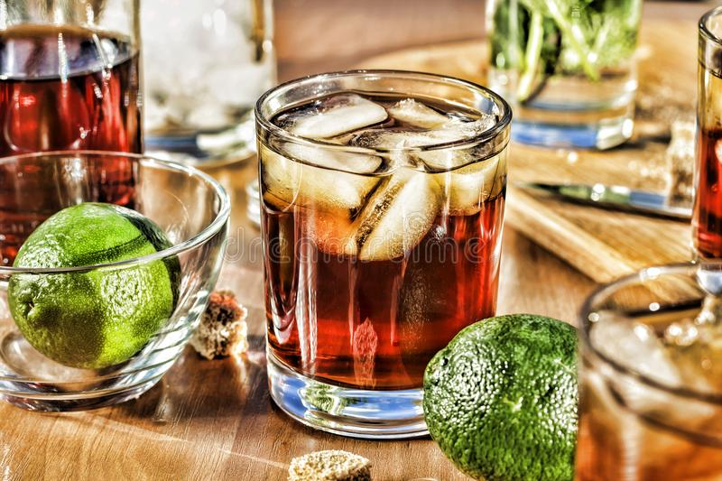 Rum with lime and cola. Alcohol Cocktail royalty free stock images