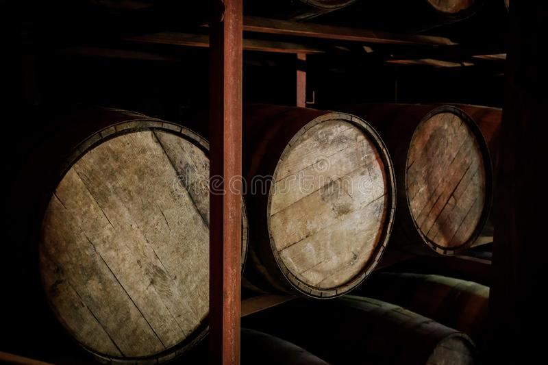 Rum or whiskey wooden barrels stacked in a warehouse.  stock images