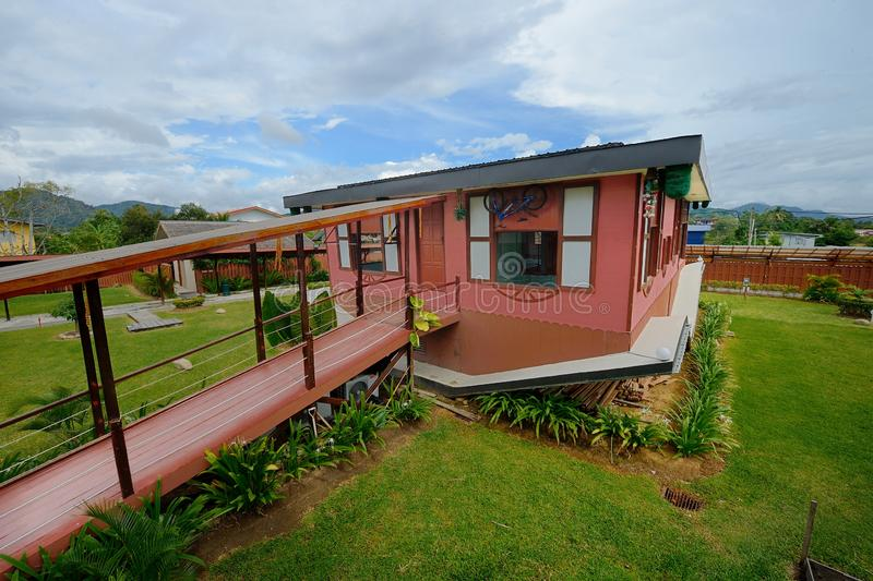 RUMAH TERBALIK. Is the first upside-down house in Malaysia. This building is situated along the main highway leading to Mount Kinabalu, Kiulu River rafting and royalty free stock photography