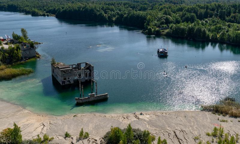 The Rummu quarry is a submerged limestone quarry located in Rummu, Estonia. Much of the natural area of the quarry is under a lake. Formed by groundwater, and royalty free stock images