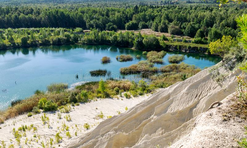 The Rummu quarry is a submerged limestone quarry located in Rummu, Estonia. Much of the natural area of the quarry is under a lake. Formed by groundwater, and royalty free stock photos