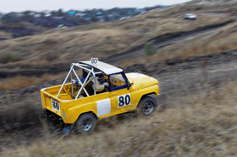 Rumpled 4wd vehicles racing on track. stock image