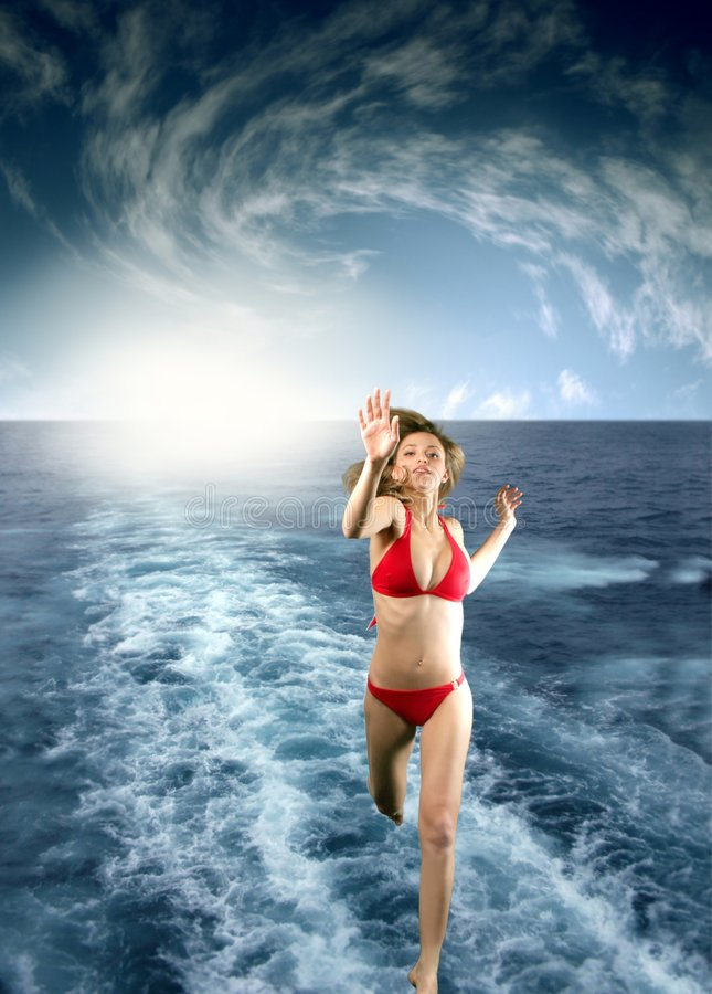 Run 15. A beautiful girl run on the water royalty free stock photography