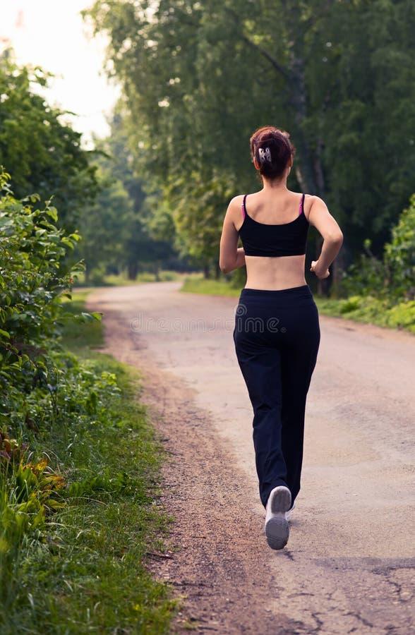 Run. Morning run on rural road royalty free stock photos
