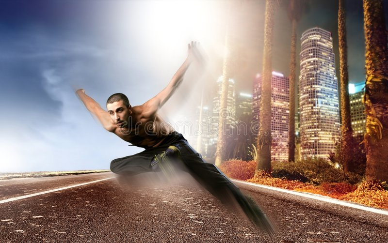 Run. A young man run and dance on the street royalty free stock photography