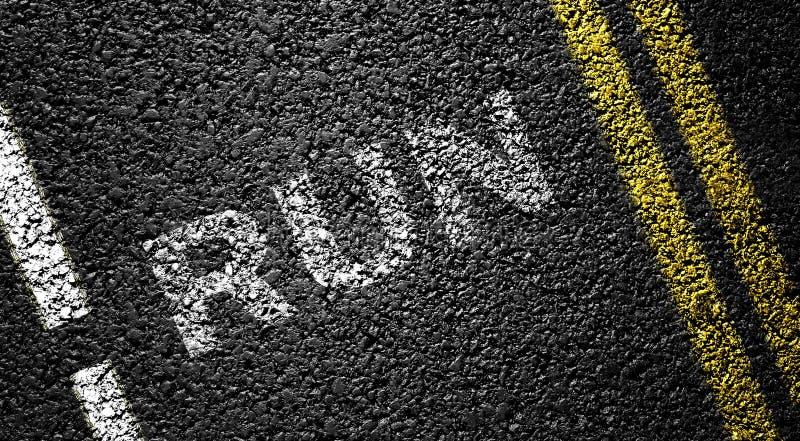 Run. On the asphalt road stock image