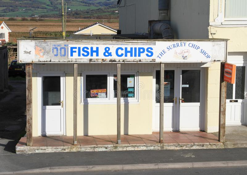 Run down fish and chip shop. The Surrey fish and chip shop in Borth, Ceredigion, Wales. The image shows a run down fish and chip shop in a Welsh coastal town stock photography