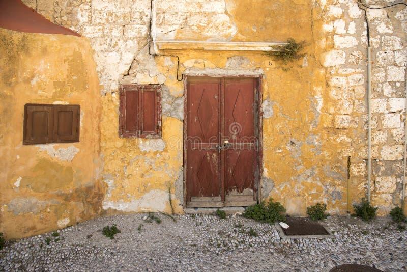 Run down houses near the Church of Saint-Marie-du-Bourg stock photos