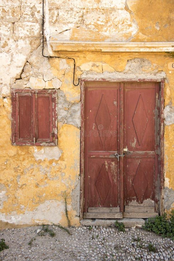 Run down houses near the Church of Saint-Marie-du-Bourg royalty free stock image