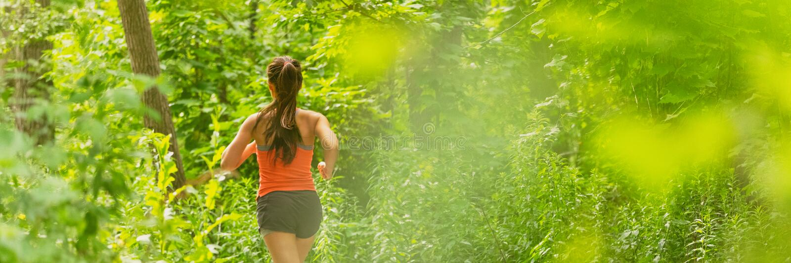 Run panoramic fit active lifestyle of runner woman running in summer background banner outdoor in city park green nature. Athlete. Training stock photos