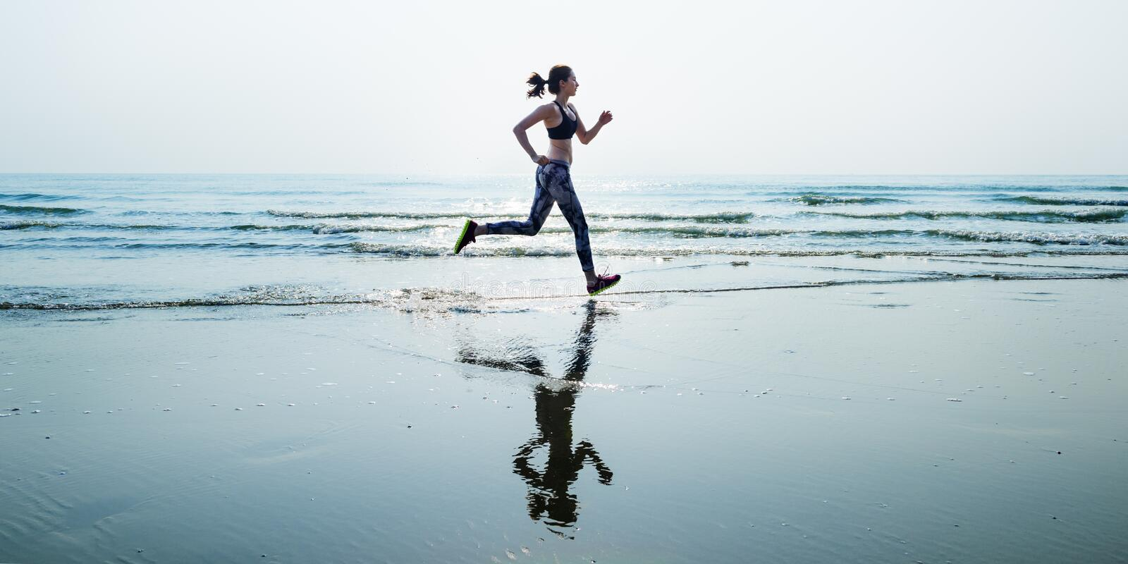 Run Sea Sand Sport Sprint Relax Exercise Beach Concept stock images