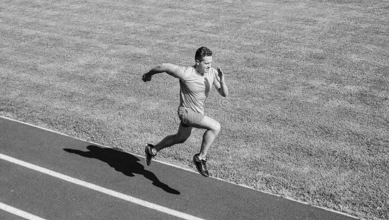 Run into shape. Running challenge for beginners. Athlete run track grass background. Sprinter training at stadium track. Runner captured in midair. Short stock image