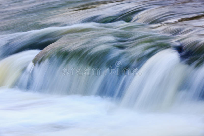 Run of water. Quick run water on mountain stream stock images