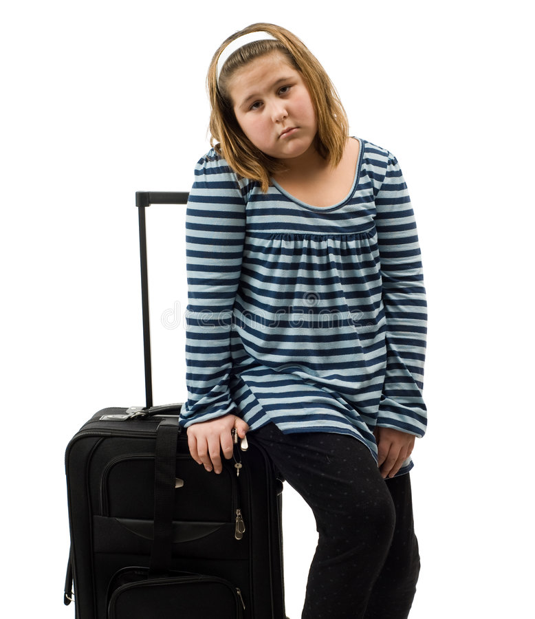 Runaway. A runaway girl with her luggage, isolated against a white background stock photography
