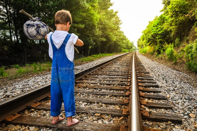 A Runaway Boy. Standing on a train track looking down stock photo