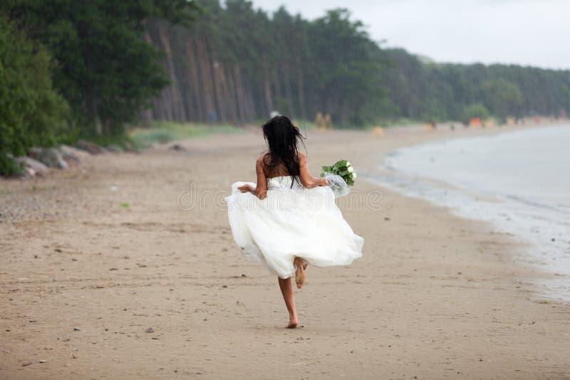 Runaway bride. In the rain stock photography