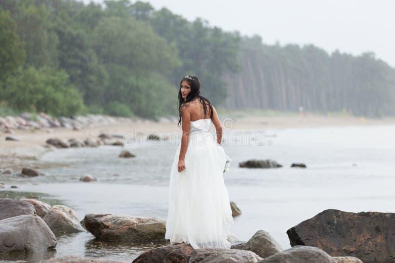 Runaway bride. Under the rain stock photo