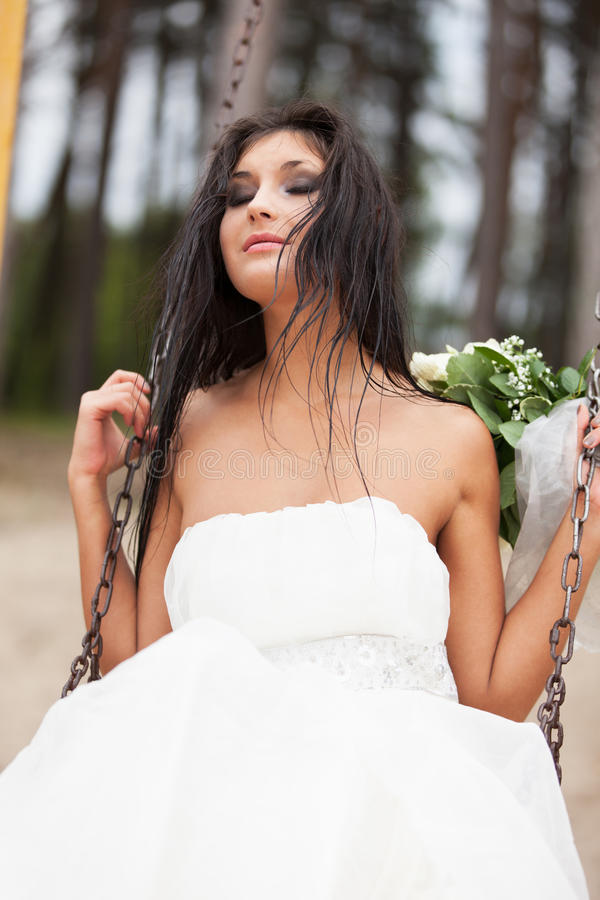 Runaway bride. On the swing stock photos