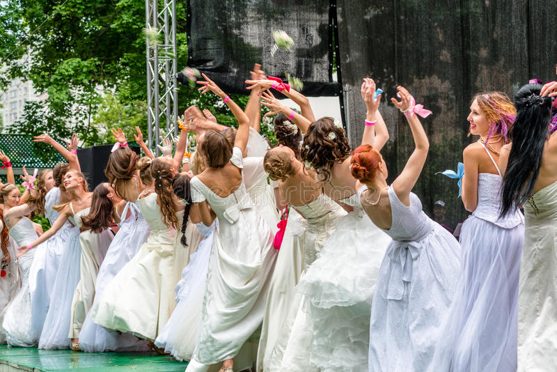 Runaway Brides Cosmopolitan, Moscow, 2013. MOSCOW, RUSSIA - 25 MAY: Runaway Brides Cosmopolitan took place in Ermitage Garden. Brides throwing wedding bouquets royalty free stock photography