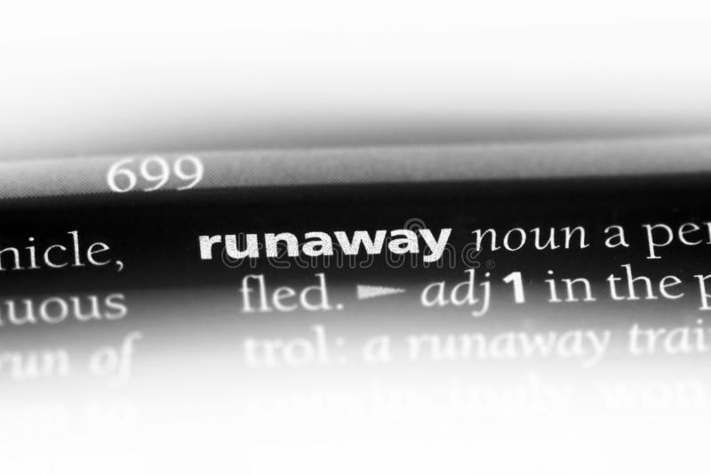 Runaway. Word in a dictionary.  concept stock image