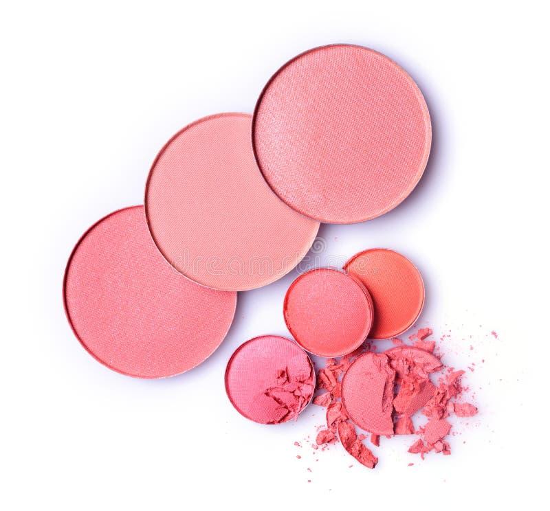 Runda rosa färger kraschade rouge och ögonskugga för makeup som prövkopia av den kosmetiska produkten royaltyfri bild