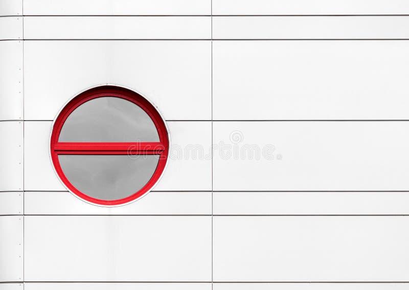 Rundat fönster som den abstrakta arkitekturdetaljen royaltyfri bild