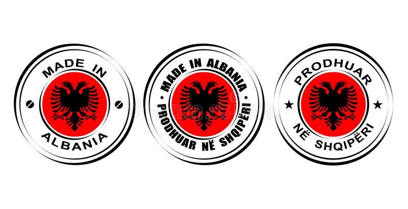 Rundes Aufkleber ` gemacht in Albanien-` mit Flagge, doppelte Adlerikone vektor abbildung