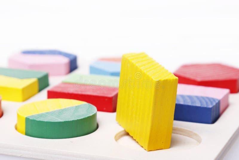 Rundes Loch der quadratischen Puzzlespielklammer lizenzfreies stockbild