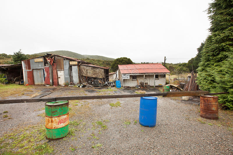 Rundown and ramshackle home. Queenstown, Australia-March 5, 2012. Rundown and ramshackle home and sheds on a property on the outskirts of the west coast township stock images