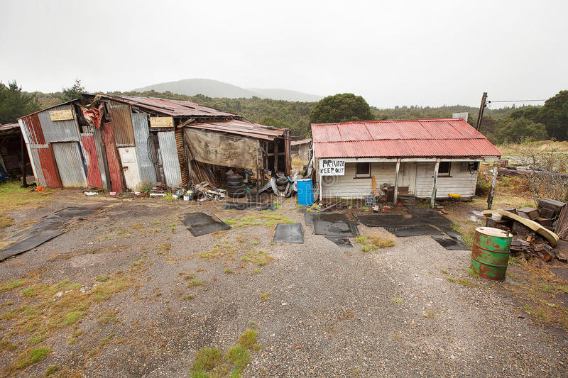 Rundown and ramshackle home. Queenstown, Australia-March 5, 2012. Rundown and ramshackle home and sheds on a property on the outskirts of the west coast township stock photography