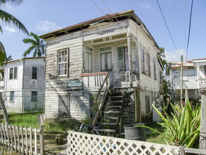 Rundown house in Belize City stock photo