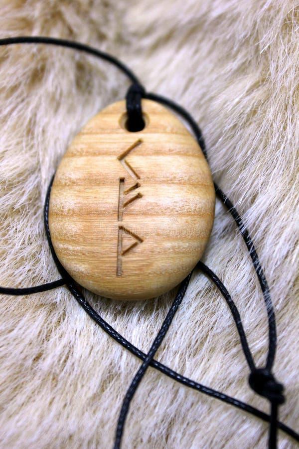 Rune amulet. Kenaz Fehu Wunjo rune amulet royalty free stock image