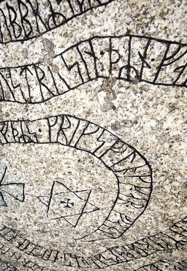 Rune stone. Inscriptions on an ancient Scandinavian rune stone stock images
