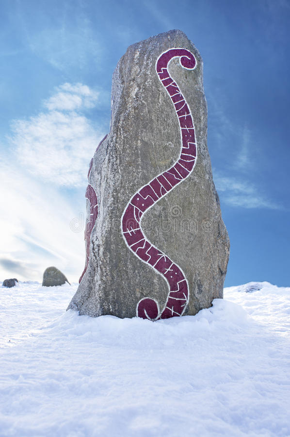 Rune stone. On cold winter day with blue sky stock images