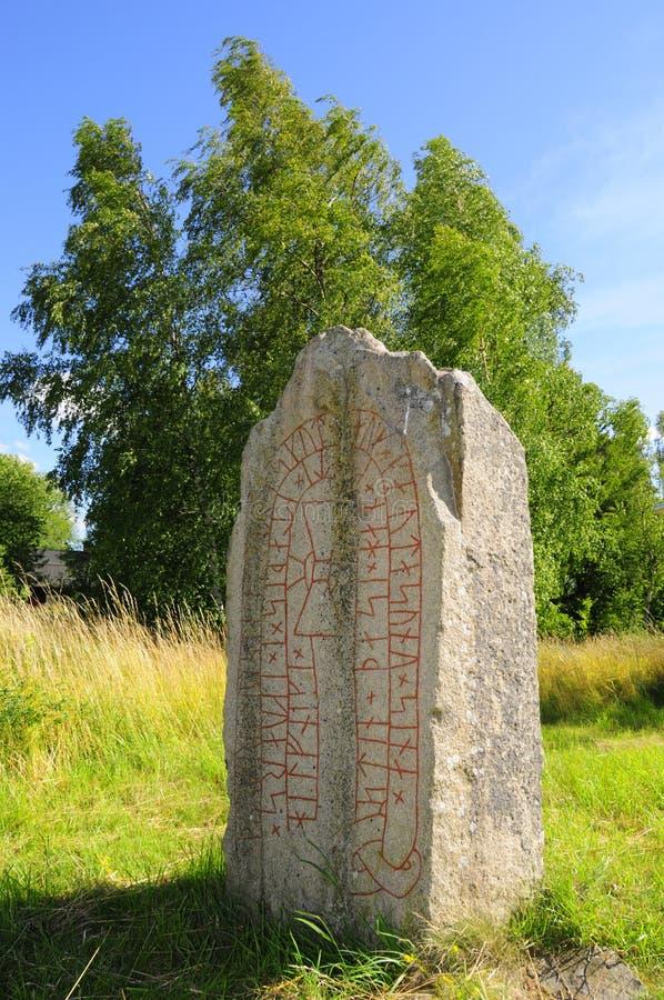 Rune stone. Ancient rune stone in Sweden stock image