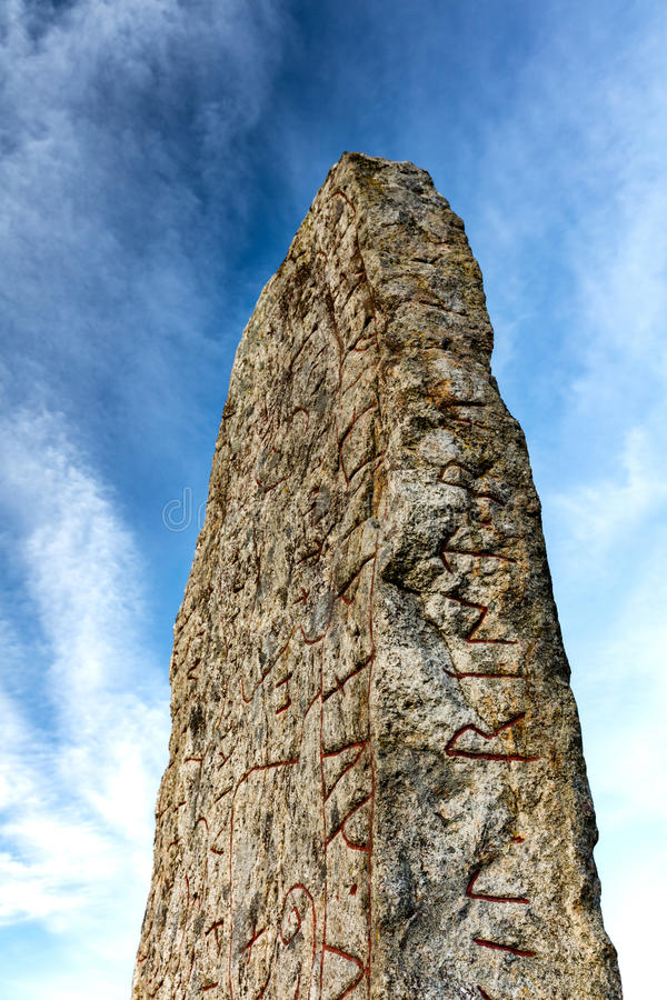 Rune stone. On a bright day, sky with light clouds royalty free stock images