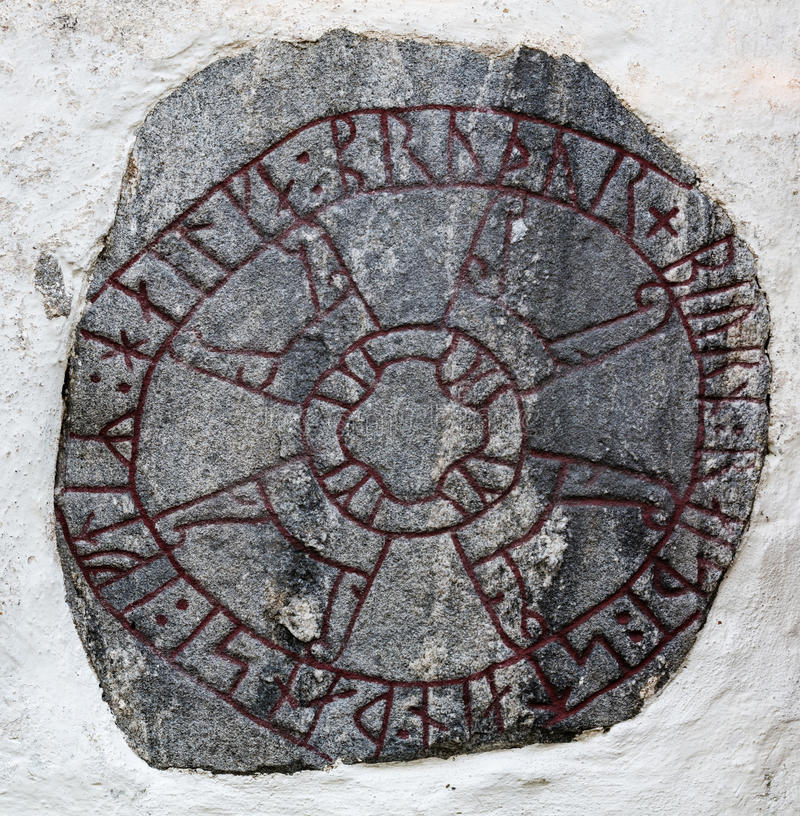 Rune stone. A rune stone built in a white wall stock images