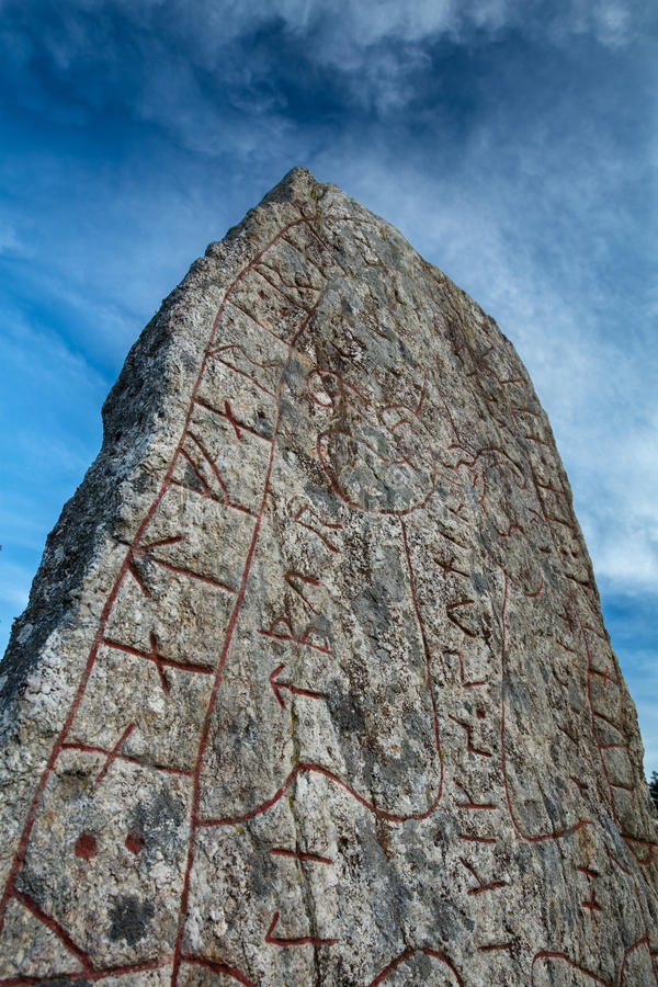 Rune stone and a dramatic sky. With dark clouds stock photos