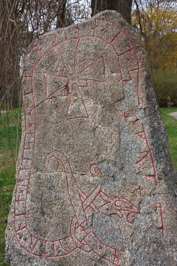 Rune stone. Viking Rune stone in the hamlet of Sigtuna, Sweden royalty free stock image
