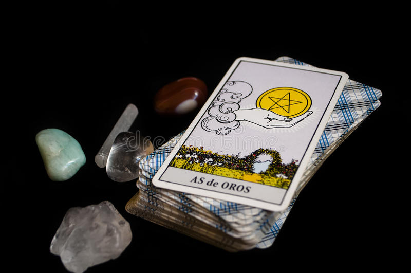 Runes and tarot cards. Divination and prediction on runes and Tarot, mysticism or esoteric isolated on black background royalty free stock photography