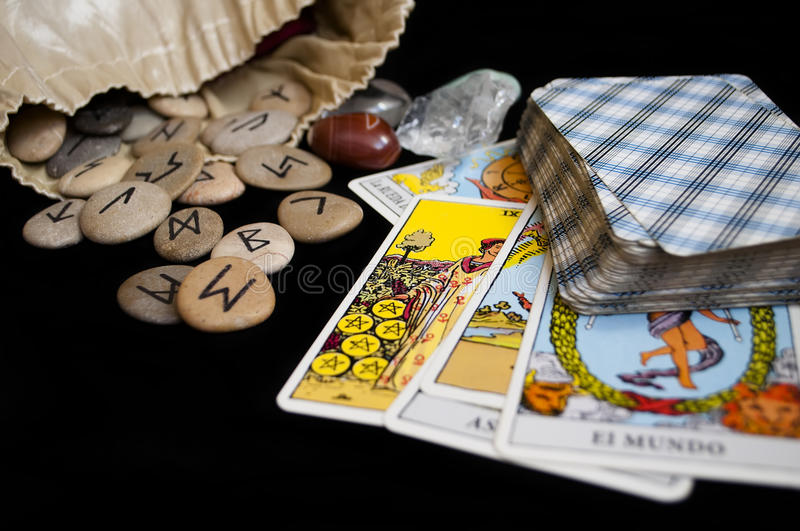 Runes and tarot cards. Divination and prediction on runes and Tarot, mysticism or esoteric isolated on black background royalty free stock image