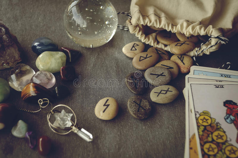 Runes and tarot cards. Divination and prediction on runes and Tarot, mysticism or esoteric isolated on grey background stock photo