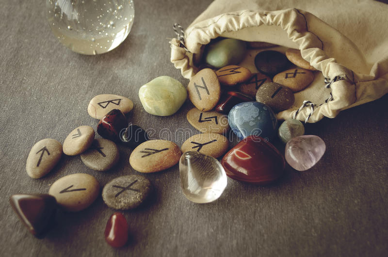 Runes and tarot cards. Divination and prediction on runes and Tarot, mysticism or esoteric isolated on grey background royalty free stock photo