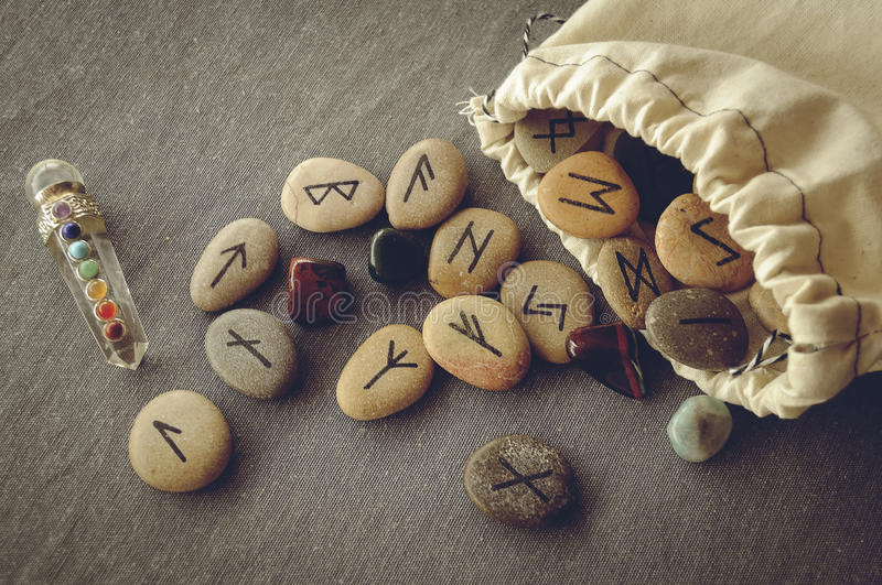 Runes and tarot cards. Divination and prediction on runes and Tarot, mysticism or esoteric isolated on grey background royalty free stock image